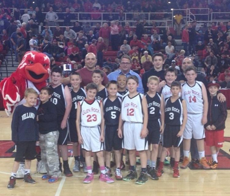 Aidan Cassidy and his team pose at a Saint John's game in 2013. This was his basketball team in sixth grade.