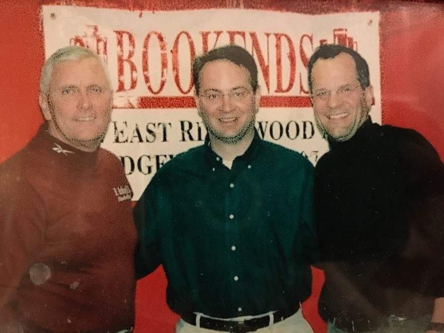 Posing for a picture, St. Anthony's coach Bob Hurley, author Adrian Wojnarowski pose with Bookends owner Walter Boyer. Bookends hosted the signing of Wojnarowski's book The Miracle of St. Anthony, a story about Hurley coaching his basketball team.