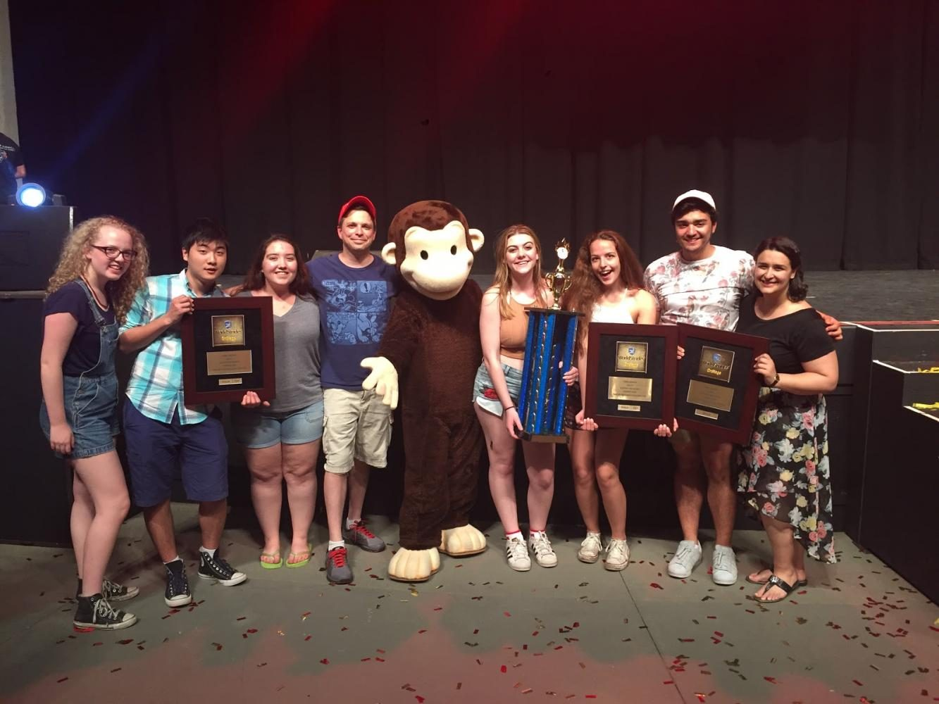 Representatives from the Chamber, Women's, and Concert Choirs pose as they accept their awards along with their directors, Carl Helder and Anna Lilikas. All three choirs were ranked in the gold division at the Worldstrides choral competition at Universal Studios in Orlando, Florida.