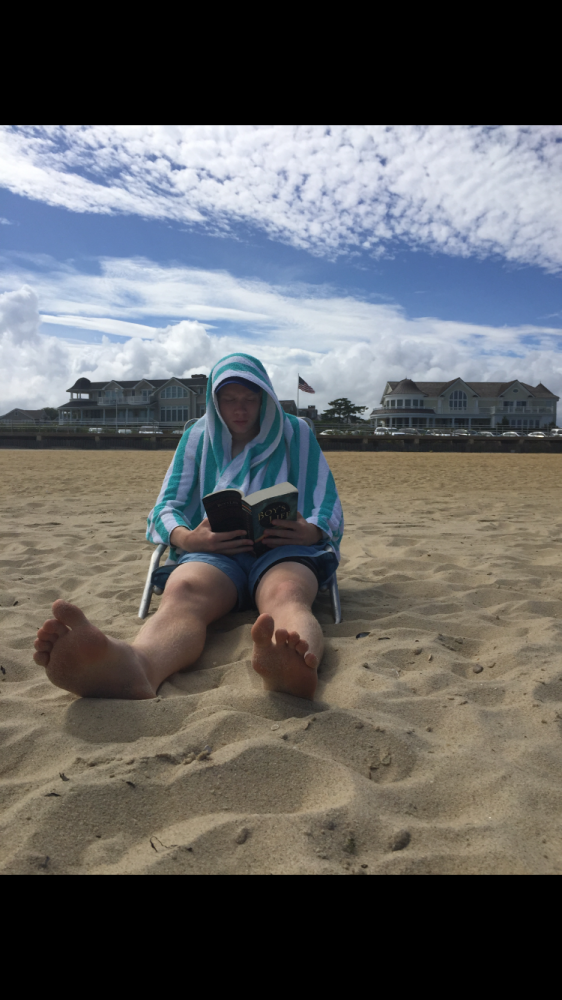 Quinn takes a load off at Spring Lake beach and reads one of his favorite book. He was celebrating his brothers fourteenth birthday at the time