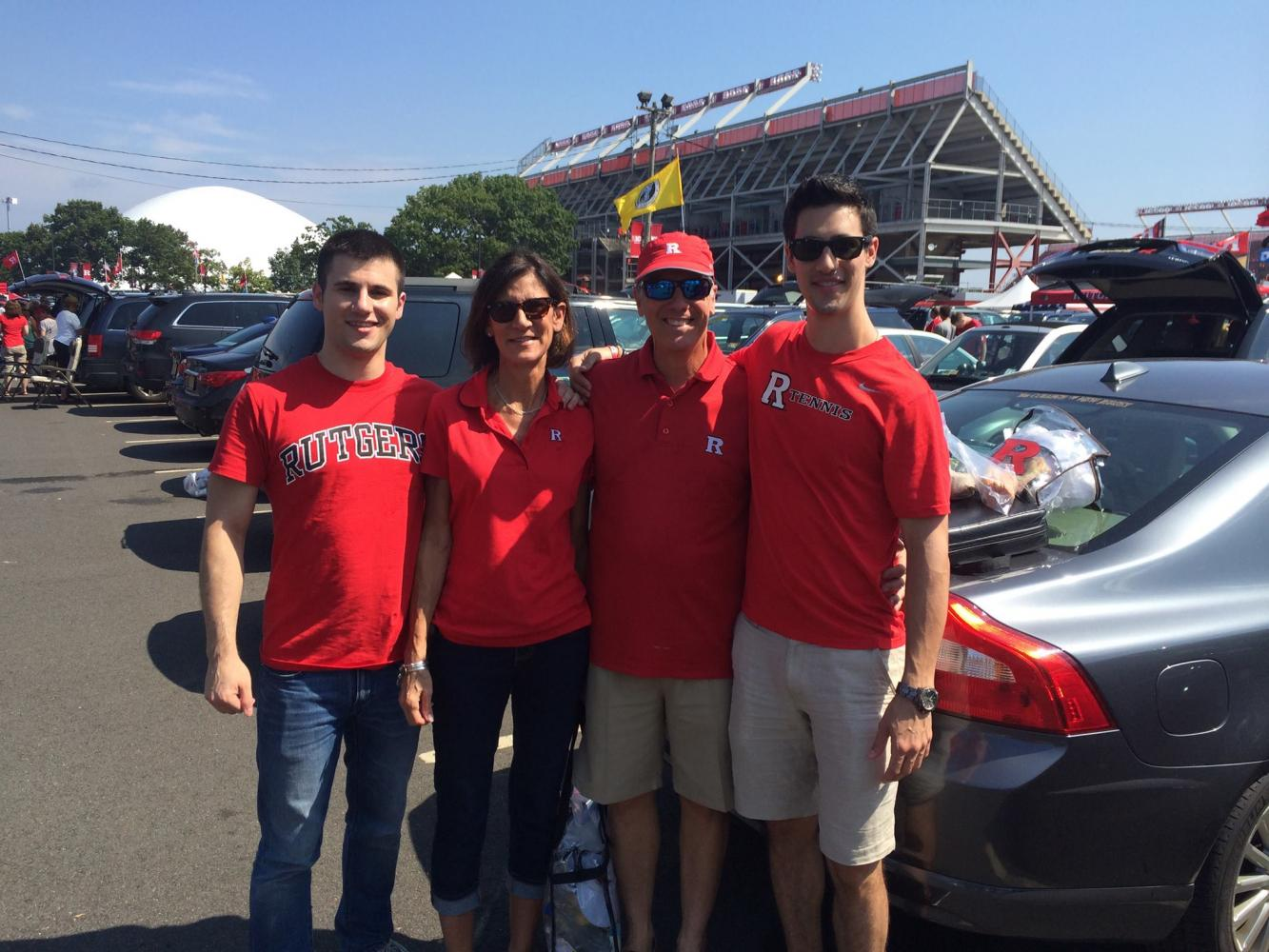 Brett, Judith, Scott, and Scott Sr. pose for a photograph at a Rutgers football game. The photo was taken a few years before Scott's mother passed away from cancer, sparking a journey -- both inner and outer -- that would change his future.