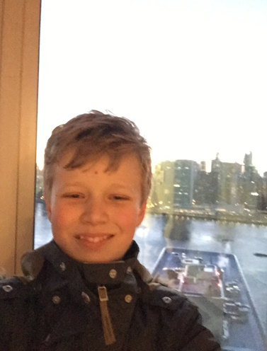 Noah poses in front of the city skyline. The trip was to New York City.