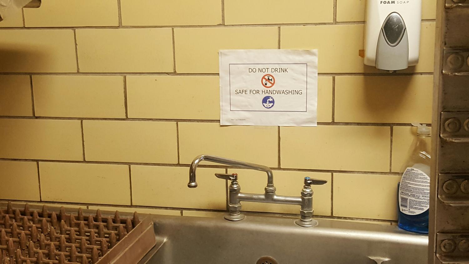 Testing 194 samples in the district, officials discover that 25 water outlets exceeded the legal limit of 15 ug/l in parts per billion. The sink in cafeteria cookie room is one such spigot, now advising that the water is not for consumption.