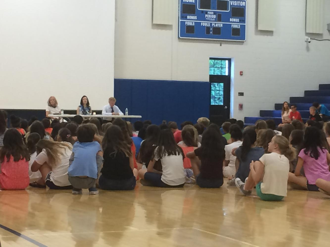 From left to right; Vera Chapman, Barbara Wind; Michael Zeiger; Students watch survivors discuss the Holocaust in the George Washington Middle School gym. Moments before, a candle was lit to remember victims of the Holocaust.