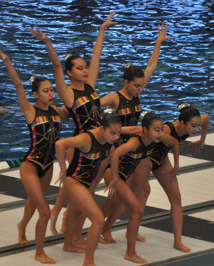 Erica and her teammates pose before beginning a routine at the Junior Olympics last year.