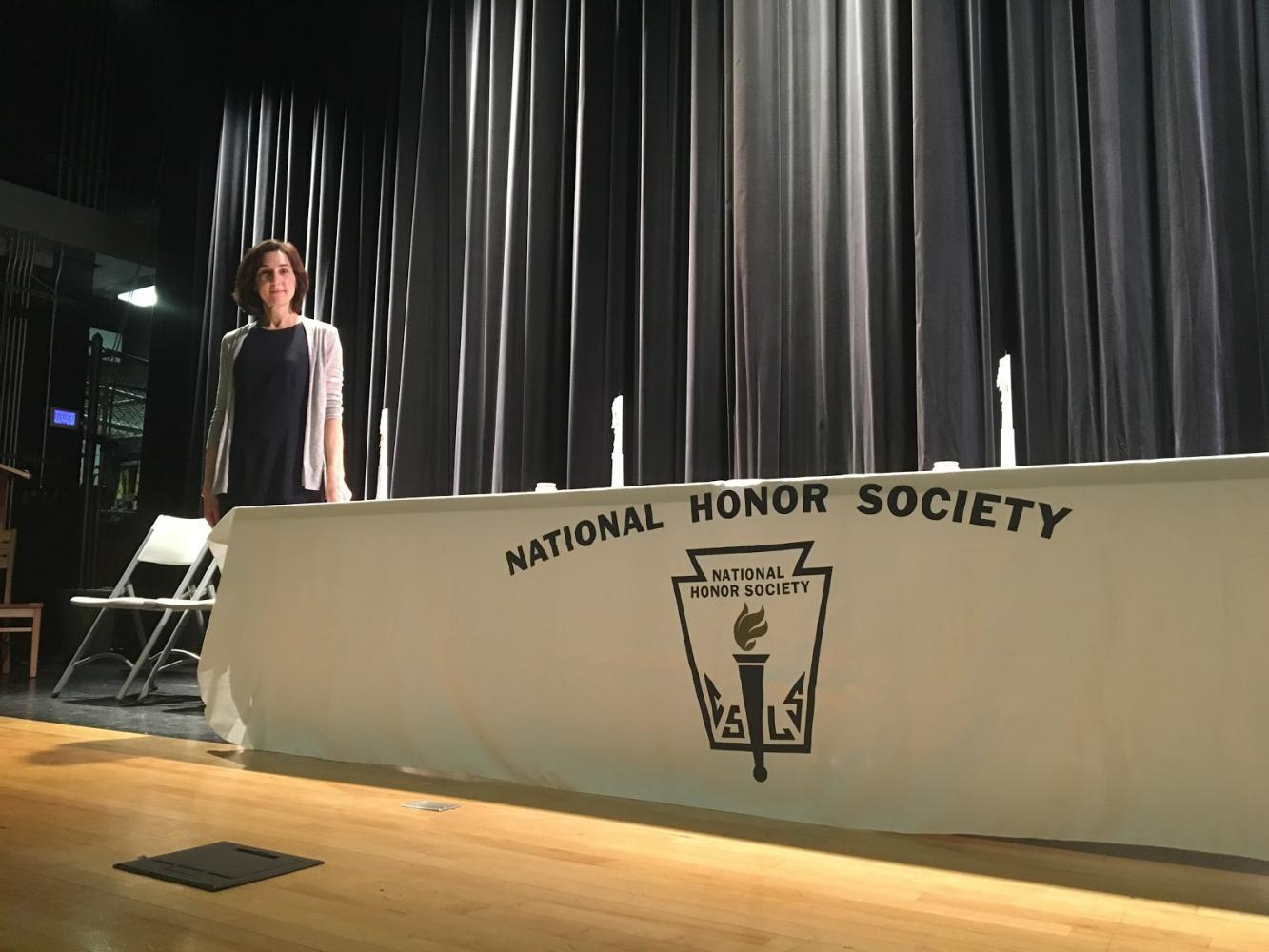 National Honor Society adviser, Donna Maasarani poses for a photo after the induction ceremony.