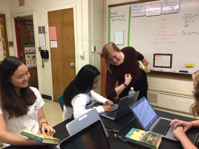 Helping juniors Emily Silvestri and Nah Lee, English teacher Susan Wechtler aids students with classwork. Before she moved to the high school, Wechtler previously taught eighth graders and worked at the middle school.