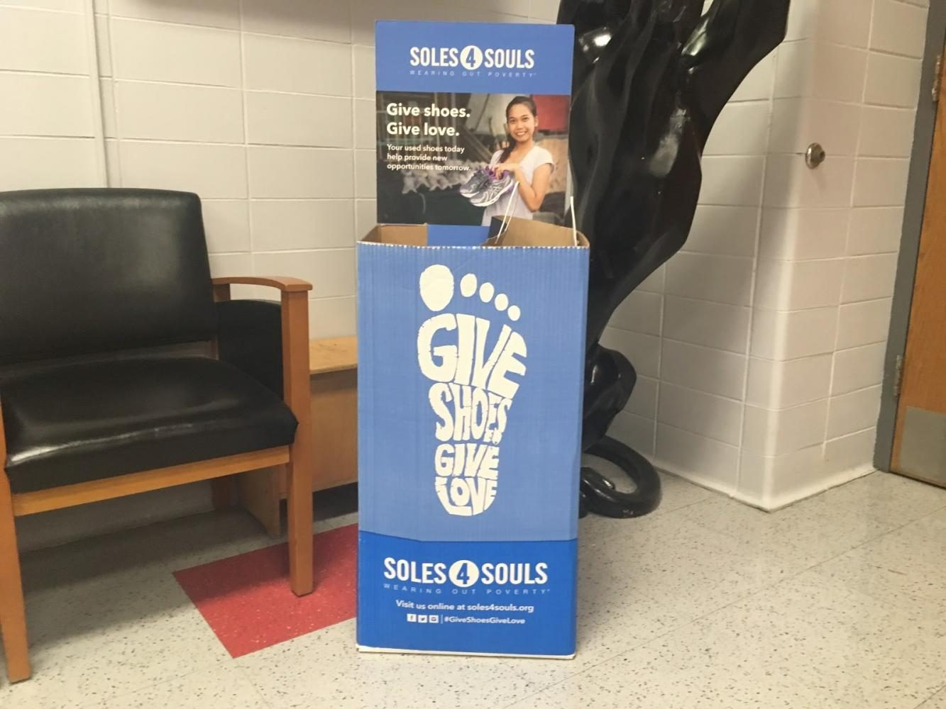 Waiting+for+footwear+in+the+Hamilton+lobby%2C+the+Soles4Souls+donation+box+is+set-up+to+collect+unused+shoes+to+help+those+in+need.+Students+in+the+local+branch+hope+to+raise+15%2C000+shoes+by+the+end+of+October.