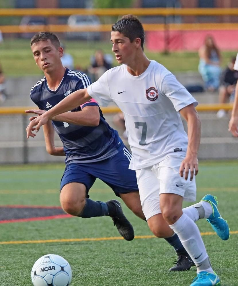 Nick Rogers carries the ball down the field. Rogers scored the game tying goal in the second half. Glen Rock prevailed 4-3.