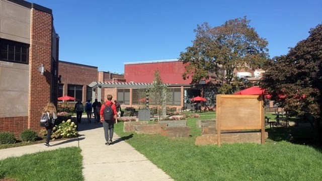 Students+stroll+around+the+courtyard+as+they+walk+by+the+outdoor+classroom%2C+pergola%2C+sculptures+and+various+plants.+The+courtyard+was+redone+for+the+new+school+year+and+was+dedicated+to+former+art+teacher%2C+Norma+Klau.+