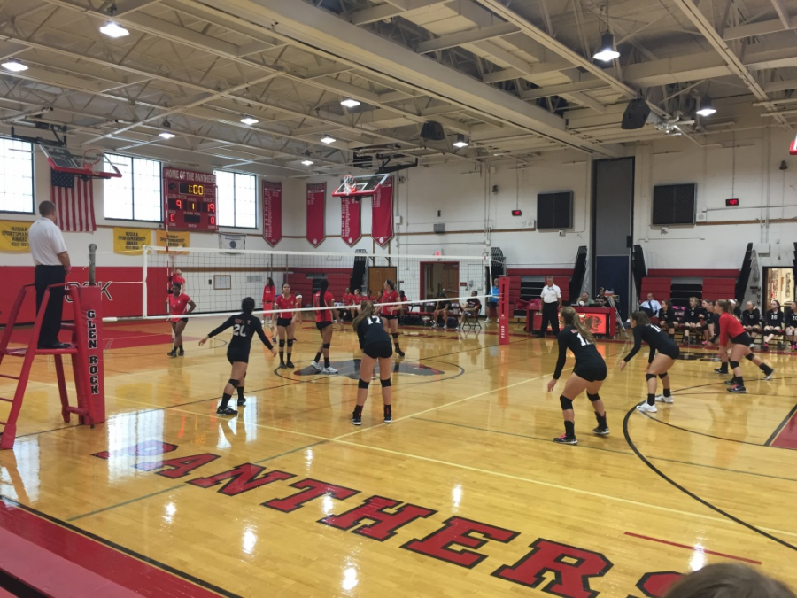 The varsity volleyball team prepares for a serve from Elmwood Park during the second match.  Glen Rock lost 2-0 to Elmwood Park. This is the second time the volleyball team lost to Elmwood Park this season, also falling 2-0 in its first match.