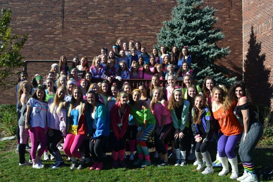 The Class of 2017 girls sport a 1980's-athletic-wear-inspired group costume.