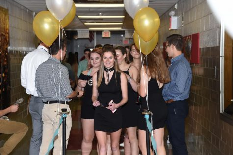 More than 300 students wait in line to enter the homecoming dance.