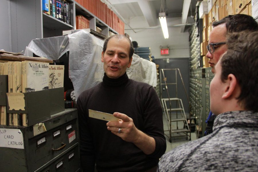 Jeff Roth gives the students a tour of the New York Times morgue and shows them a photo from a decades a old newspaper edition. The morgue sits in the basement of CUNY School of Journalism. It holds nearly 800,000 pounds of newspaper clippings, varying from clips about history to government files.