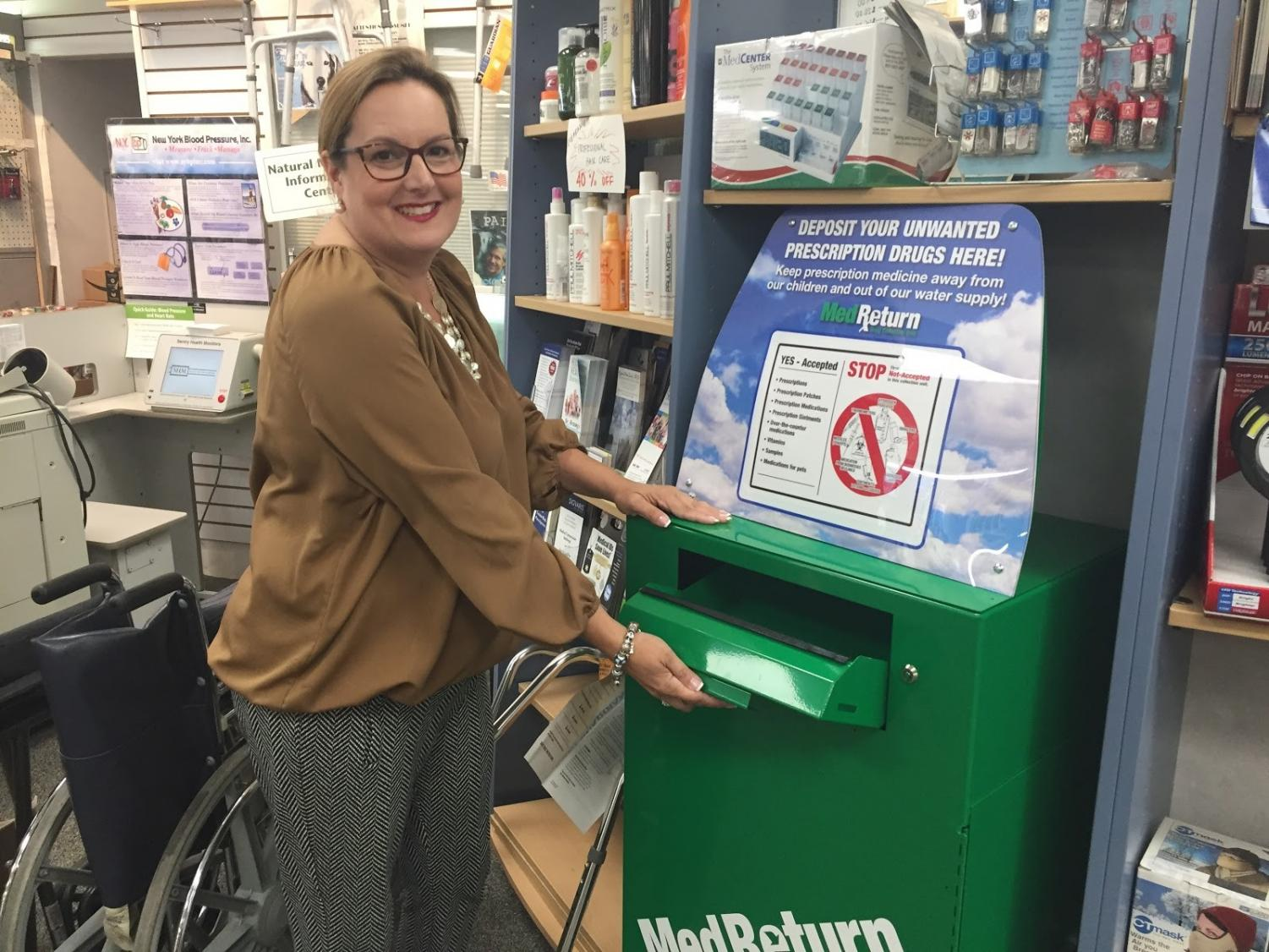 Michelle Torpey opens the new prescription drug recycle box in Rock Ridge Pharmacy. She took initiative to help people dispose of addictive opioid drugs in Glen Rock. She raised money for this box with gofundme.com.