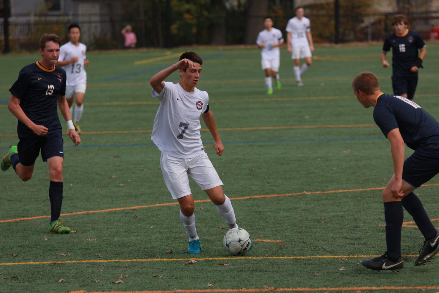 Nick Rogers keeps the ball in possession against Pequannock in the second round of the NJSIAA Tournament.  Despite losing the boys varsity soccer team played one of their best seasons in 30 years.