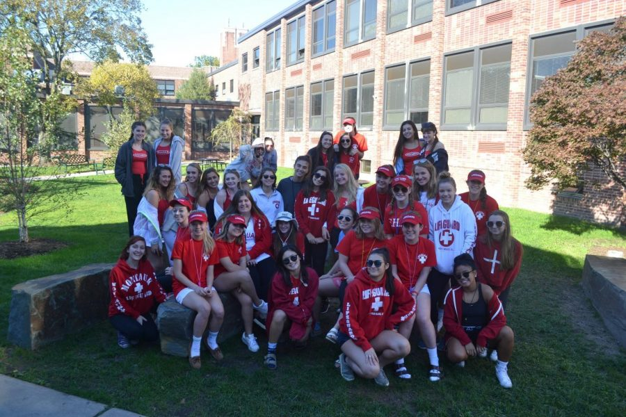 The class of 2018 girls are dressed as lifeguards for their group Halloween costume.