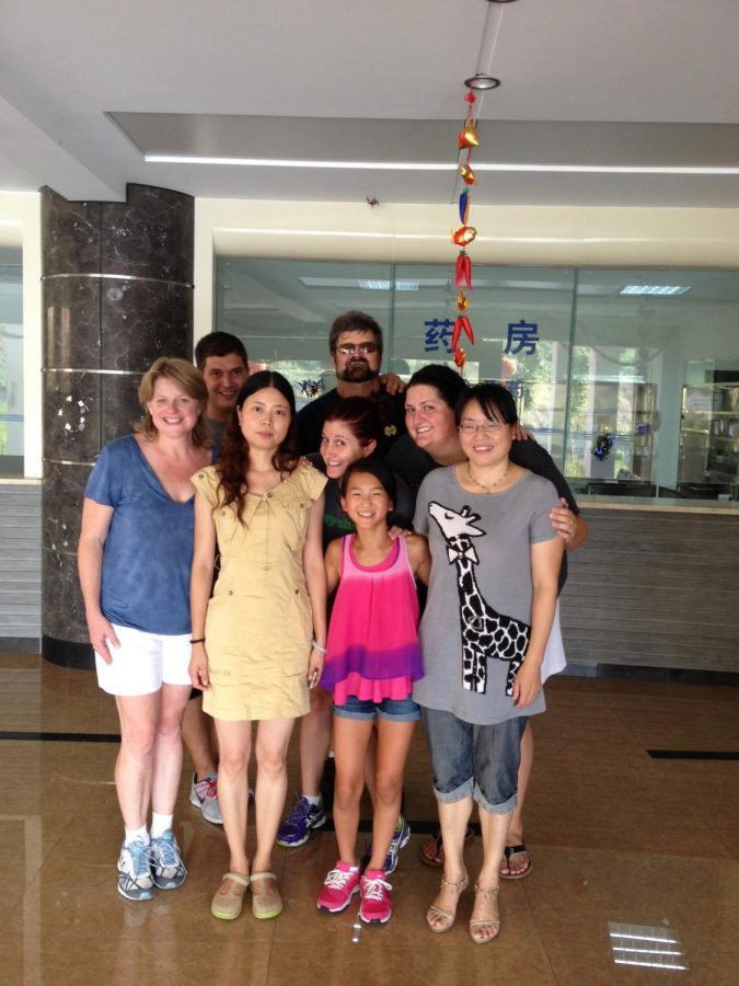 Grace, her mom Robin, dad Skip, brother Bill, and sisters Laura and Sarah are accompanied by Grace's early caregivers on their 2013 trip to China.