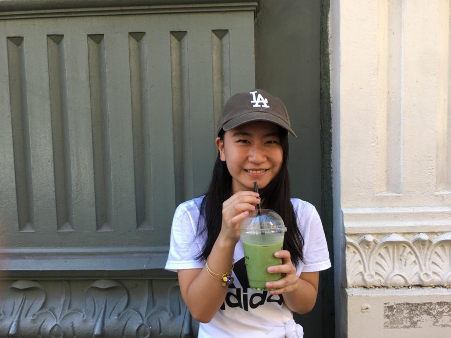 Asami Fujimoto is in New York, posing with her tea. She spent her early life in England and Japan and now living in Glen Rock.