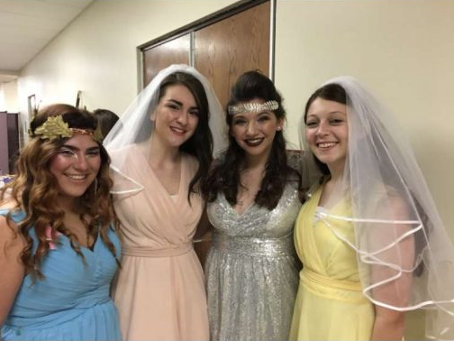 Madison Jones (far right) poses with fellow seniors during the dress rehearsal for A Midsummer Night's Dream.  She acted as a second opinion for her peers when working a scene as well as being their scene-partners.  Frankie Fontana, Tina Rivara, and Caroline Koenig joined Jones for a picture after the dress rehearsal.