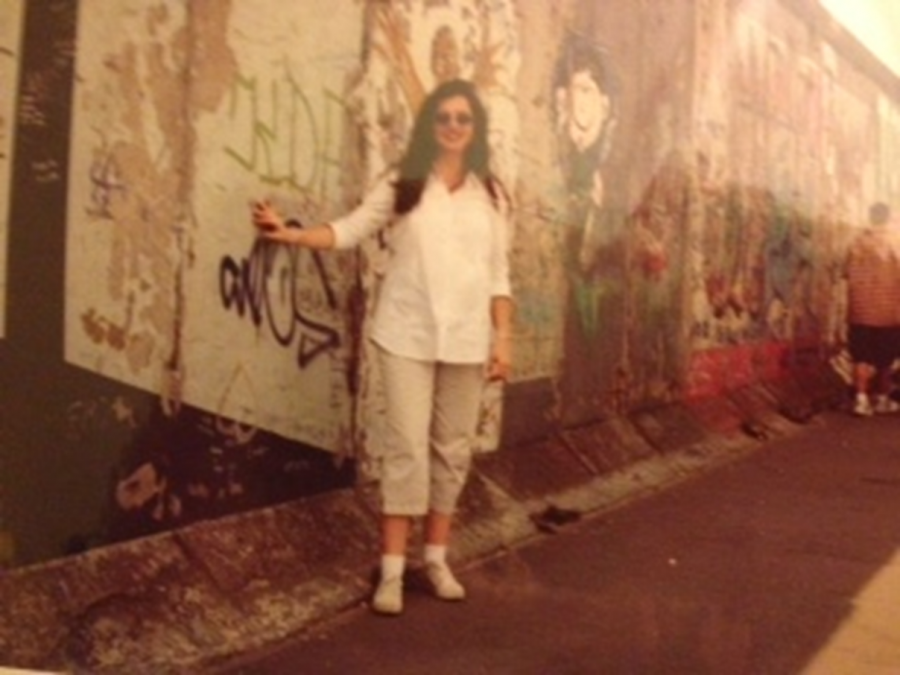 Kathleen Walter stands in front of the Berlin Wall on the West Berlin side in 2000. She traveled to Germany with her West Milford High School students on an art history field trip.