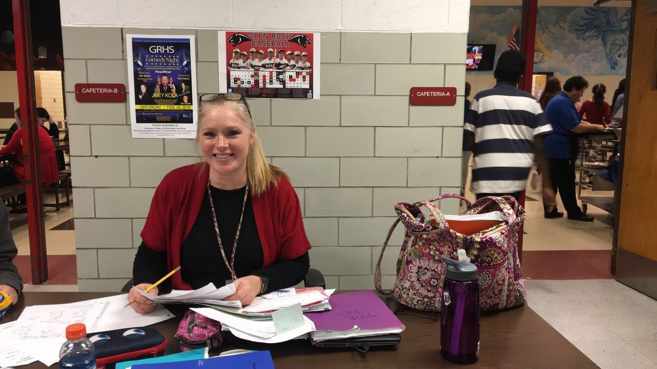 Special Education teacher, Stacie Gallo, sits at the table as she grades her students' papers. Before working at Glen Rock High school, she worked at a Child Development Center for seven years.