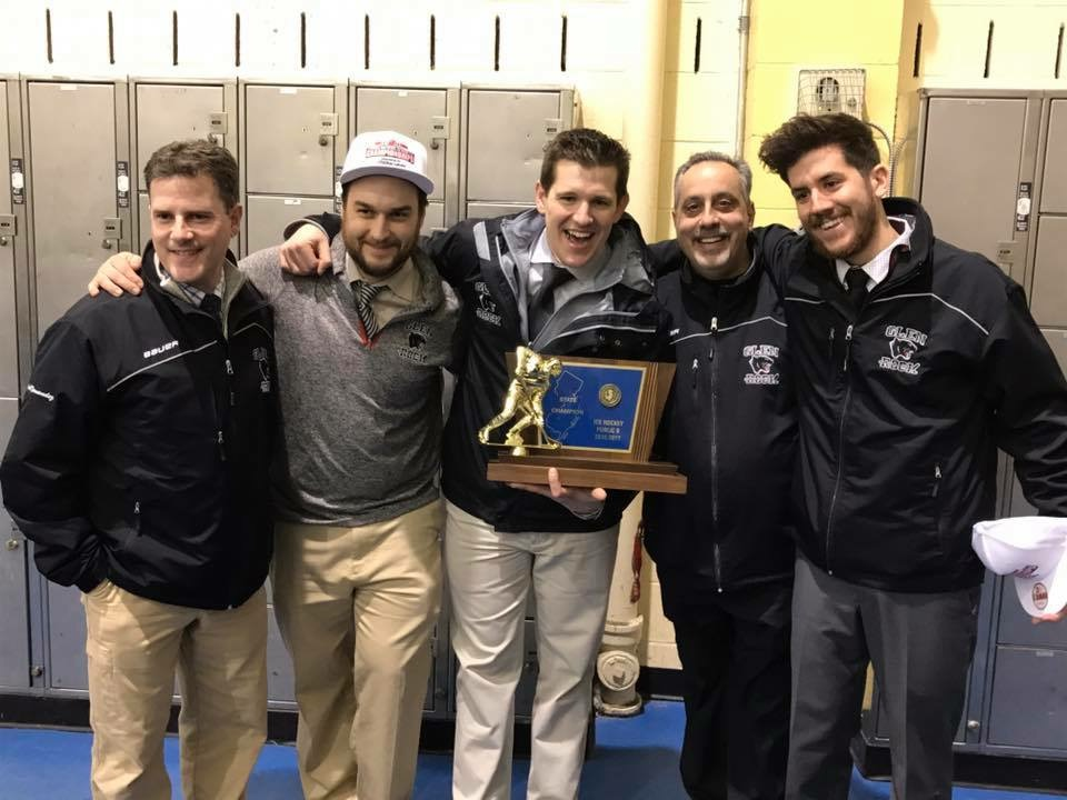 Glen Rock Varsity Coaching staff poses with the State Championship, after an 8-1 victory over Wall Township.  From left to right Sergio Fernandez, Zane Kalemba, Anthony Yelovich, Frank Del Tuffo, and Dillon Driver.