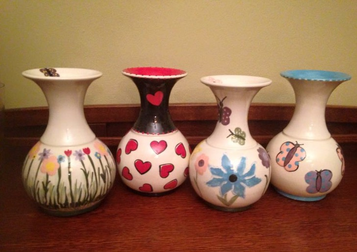 Barbra lines up four spring-themed vases for a photo. Barbra frequently customizes her pottery depending on the season, and takes inspiration from nature in almost everything.