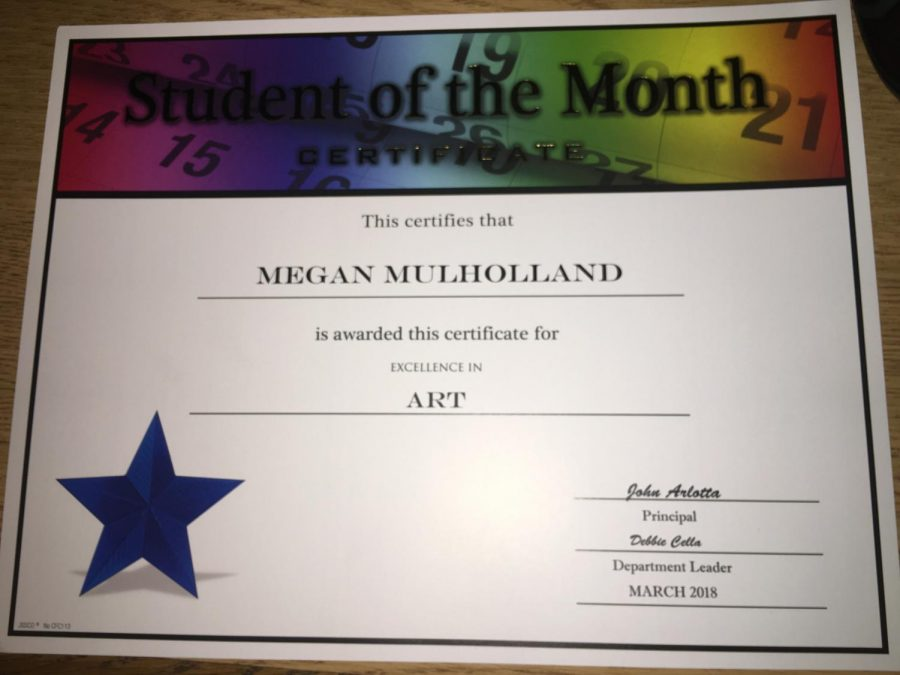 Sophomore Megan Mulholland earns a student of the month certificate in the art category. Megan felt inspired by her mom's studio to continue immersing herself in the art field.