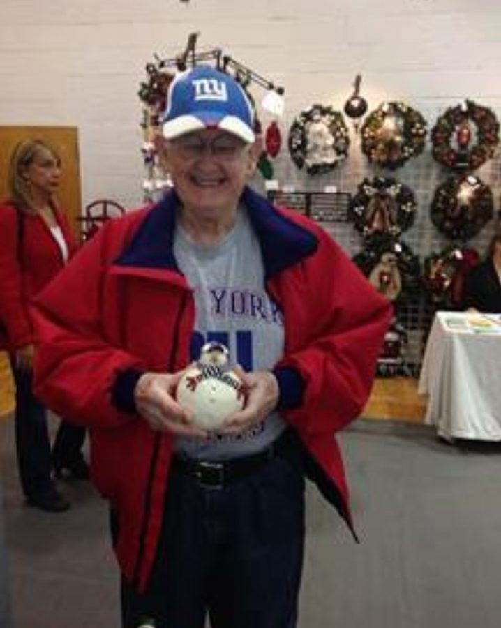 A senior citizen poses with his homemade ceramic snowman. Barbara circulated teaching at multiple assisted living homes for around three years.