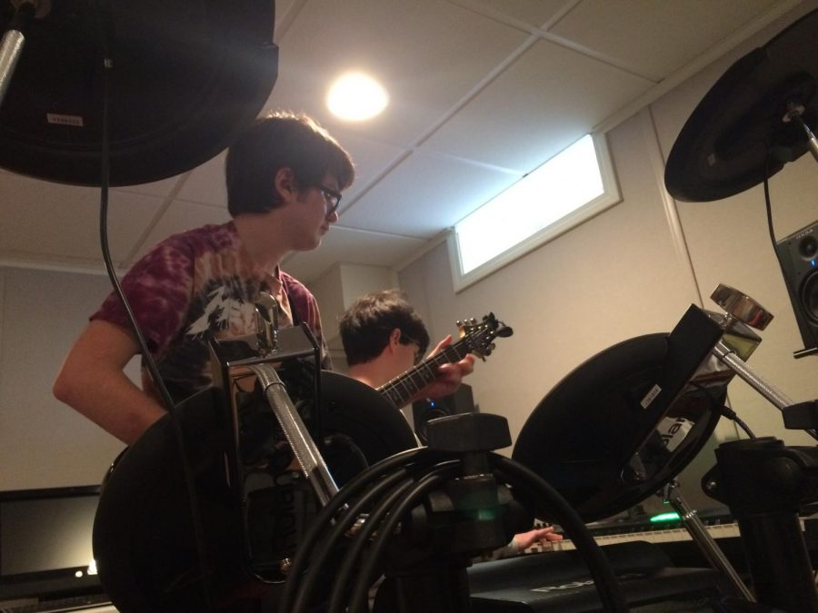 """No Info members AJ Knapp and Blaise DeLeon practice in Blaise's basement. DeLeon, the band's bassist, switched to keyboard for """"Karma Police"""" by Radiohead. Photo Credit: Julia Piermatteo"""