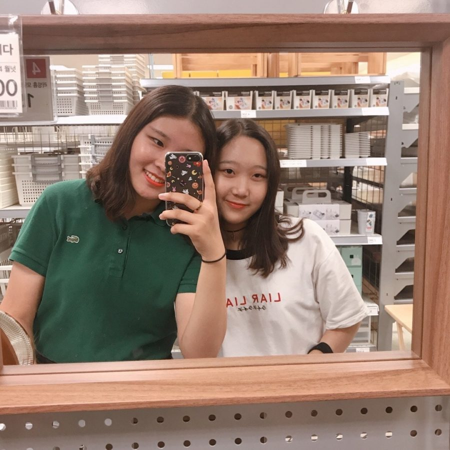 Hailey and her friend,Eunjin Lee, are posing in front of the mirror. They were really close friend and spent lots of times together. Eunjin first felt sad when she first knew that Kim will move to America.