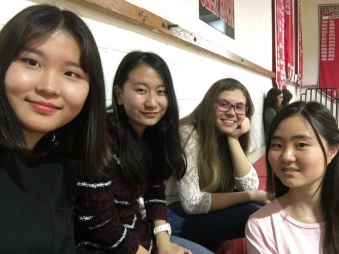 Hailey and her friends are posing in the gymnasium who are from Japan, Korea, and Slovakia. Hailey met her friends when she first moved to Glen Rock and became close friends with them.