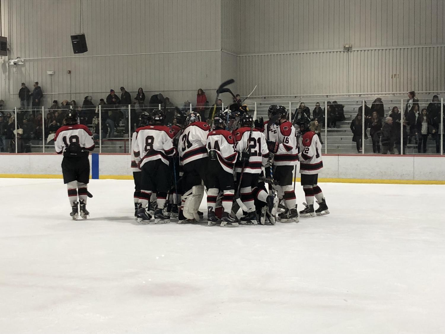 The 2017-2018 boys' ice hockey team celebrates after defeating Monville, 7-0. With a new coach and a talented roster, players are optimistic for the season ahead.