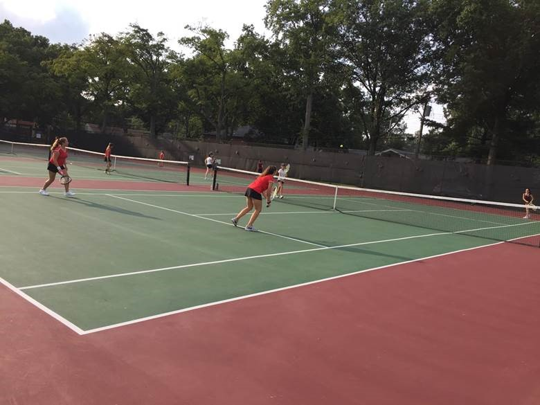 Junior+varsity+tennis+players+Jessica+Rosen+and+Matea+Damevski+compete+in+their+match+against+Leonia.+They+competed+in+a+best+out+of+three+doubles+match+and+Rosen+and+Damevski+held+an+early+lead.+However%2C+Leonia+caught+up+to+their+score+and+they+entered+a+tie+breaker.