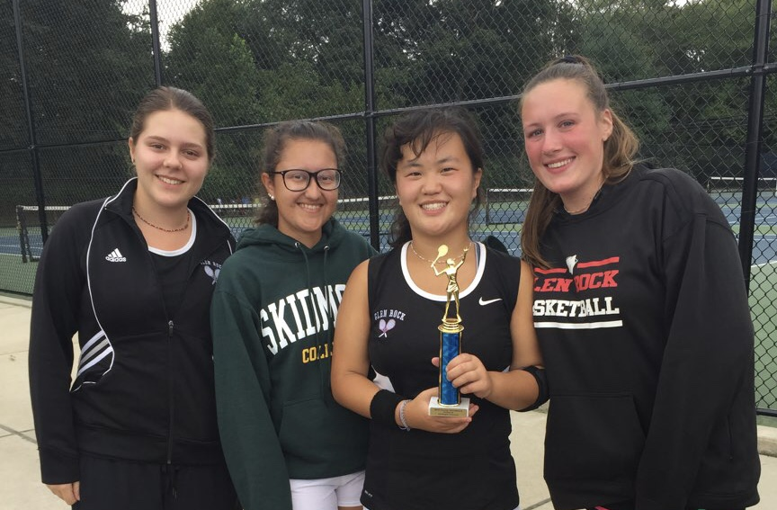 Shown from left to right are varsity tennis captains Grace Desalvo, Charlotte Arehart, Emma Mangino, and Ashley Robinson after the counties game.