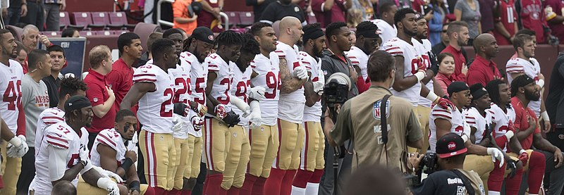 San Francisco 49ers kneel before the start of a football game in 2017. This occured over a year after Kaepernick first kneeled.