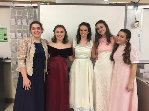 Emily Campbell poses with four of her cast mates. From left to right, juniors Sofia Nolfo and Dylaney Sabino, Emily Campbell, and juniors Caroline Goldenberg and Sofia Karras.
