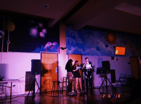 Coffeehouse emcees Rachel Goldberg, Cat Merkle, and Caroline Geoghegan introduce the next act. These three senior hosts also serve as editors-in-chief for Mobius.