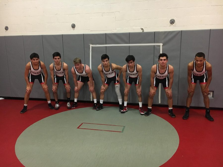 Members of the wrestling team pose for picture before practice. (From left to Right: Etai Weisman, Bryan Novick, Captain Greg Schlett, Captain Ben Or-Chen, Ryan Romeo, Ben Katzman, Owen Stephenson, Not pictured: Senior Captain Terence O'Toole)