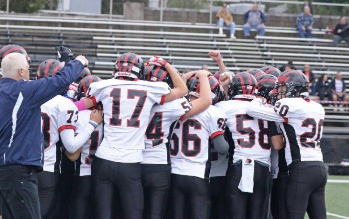 Glen Rock huddles up awaiting kick off against Lodi. Glen Rock would go on to win this game behind three total touchdowns from junior quarterback Greg Schlett. This game, however, would be senior Seve Bilbao's last game after dislocating his elbow on a touchdown pass from Schlett.