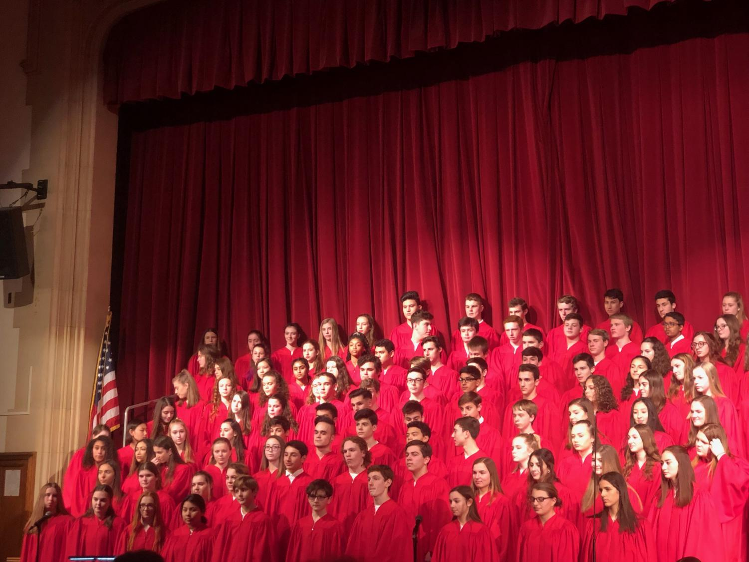 The concert choir cheerfully performing