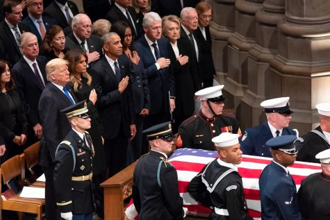 Former presidents Obama, Clinton, and Carter stand alongside President Trump at a funeral service for former president George H.W. Bush. Bush's family announced on Nov. 30 that he had passed away. He was buried next to his wife and daughter at Texas A&M University.