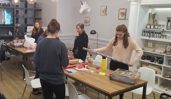 High school students wrap gifts for the Glen Rock Chamber of Commerce's holiday gift-wrapping event on Dec. 15. The event took place at the Creative Den, a new store in town where customers can take art classes ad rent the space.