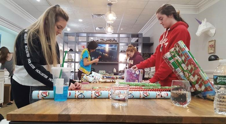 High school students wrap gifts for the Glen Rock Chamber of Commerce's holiday gift-wrapping event on Dec. 1. The event took place on Dec. 1 and 15 as an effort to bring attention to local businesses in Glen Rock. All the proceeds of this event were donated to CUMAC, an organization that fights hunger.