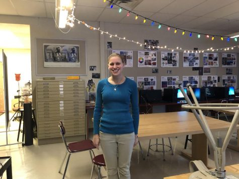 Photo teacher Jenna Cozzarelli poses by the