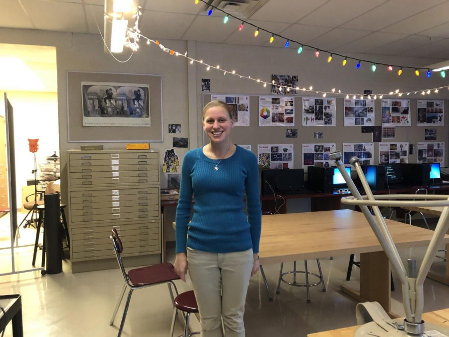 Photo teacher Jenna Cozzarelli poses by the 'fairy lights' in her classroom.