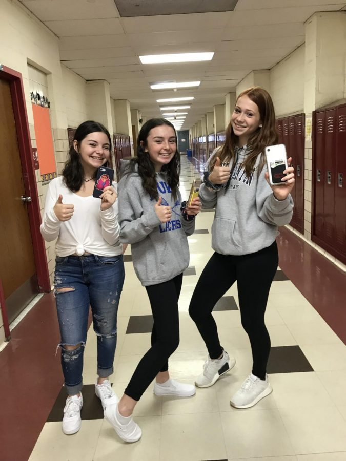 Freshmen+Devyn+Ivers%2C+Abby+McCarthy+and+Allie+Eisenberg+%28left+to+right%29+pose+with+their+smartphones.+They+all+wish+for+teachers+to+incorporate+technology+into+their+classes+more.+Some+of+their+favorite+online+classroom+activities+have+been+Kahoot+and+Quizlet+Live.%0A