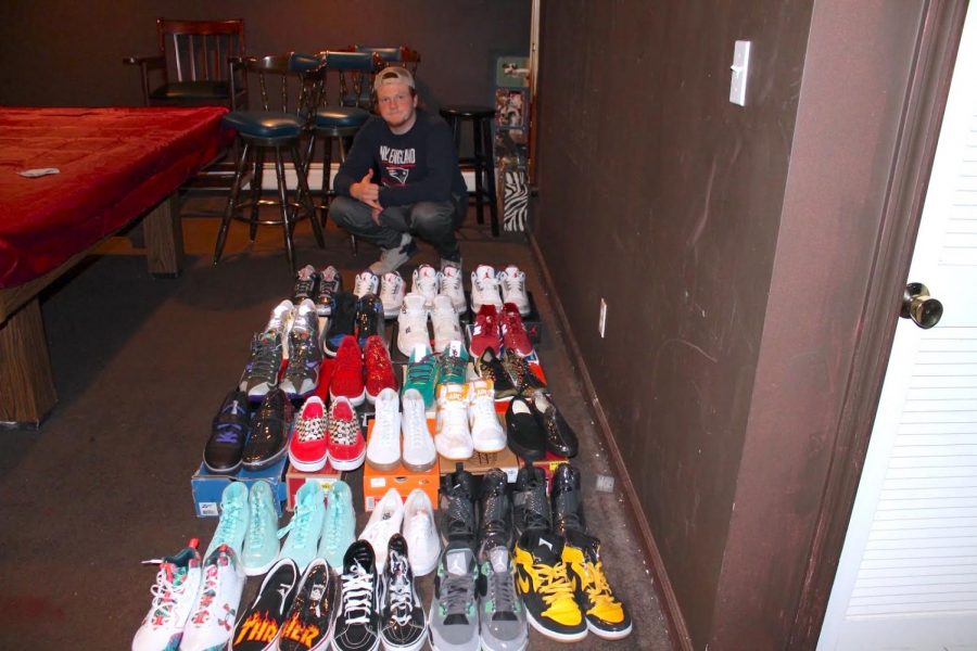 Senior Max Lindley prepares for his first garage sale. In one day, he sold approximately $500 worth inventory. Lindley created his own business called Suburban Sneaker Steals, where he buys and resells shoes and vintage clothing.