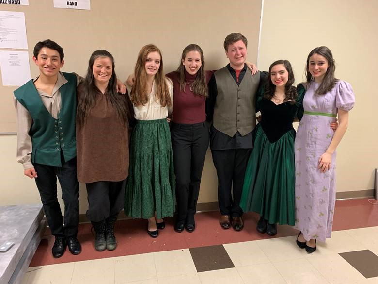 The+cast+of+Rapunzel+poses+with+their+student+director%2C+Isabel+Siggers.+Siggers+is+a+senior+and+a+member+of+the+Theatre+Company+Executive+Board+and+was+excited+to+take+on+her+role+as+a+student+director+for+%E2%80%9CWicked+and+Whimsical.%E2%80%9D+